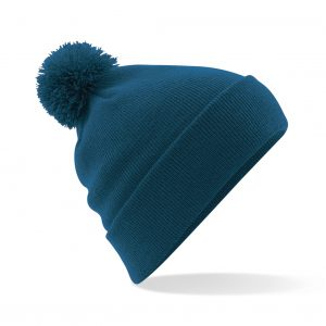 This original double layer knit cuffed design Pom Pom Beanie comes in a wide range of colours. Your logo or name can be custom embroidered on the front of this self coloured Pom Pom, ensuring that your logo stands out from the crowd! This branded pom pom is a must for inclusion in your Autumn/winter workwear/uniform or club gear collection!